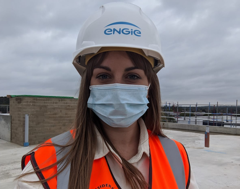 Woman in hard hat and mask